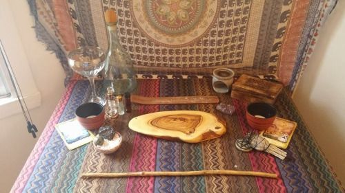This is my current temporary set up. The chalice and wood slice are new from today. Blessed Be )o(