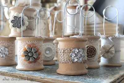 spool holders.. for anything: pictures, place card holders etc.  NEAT!