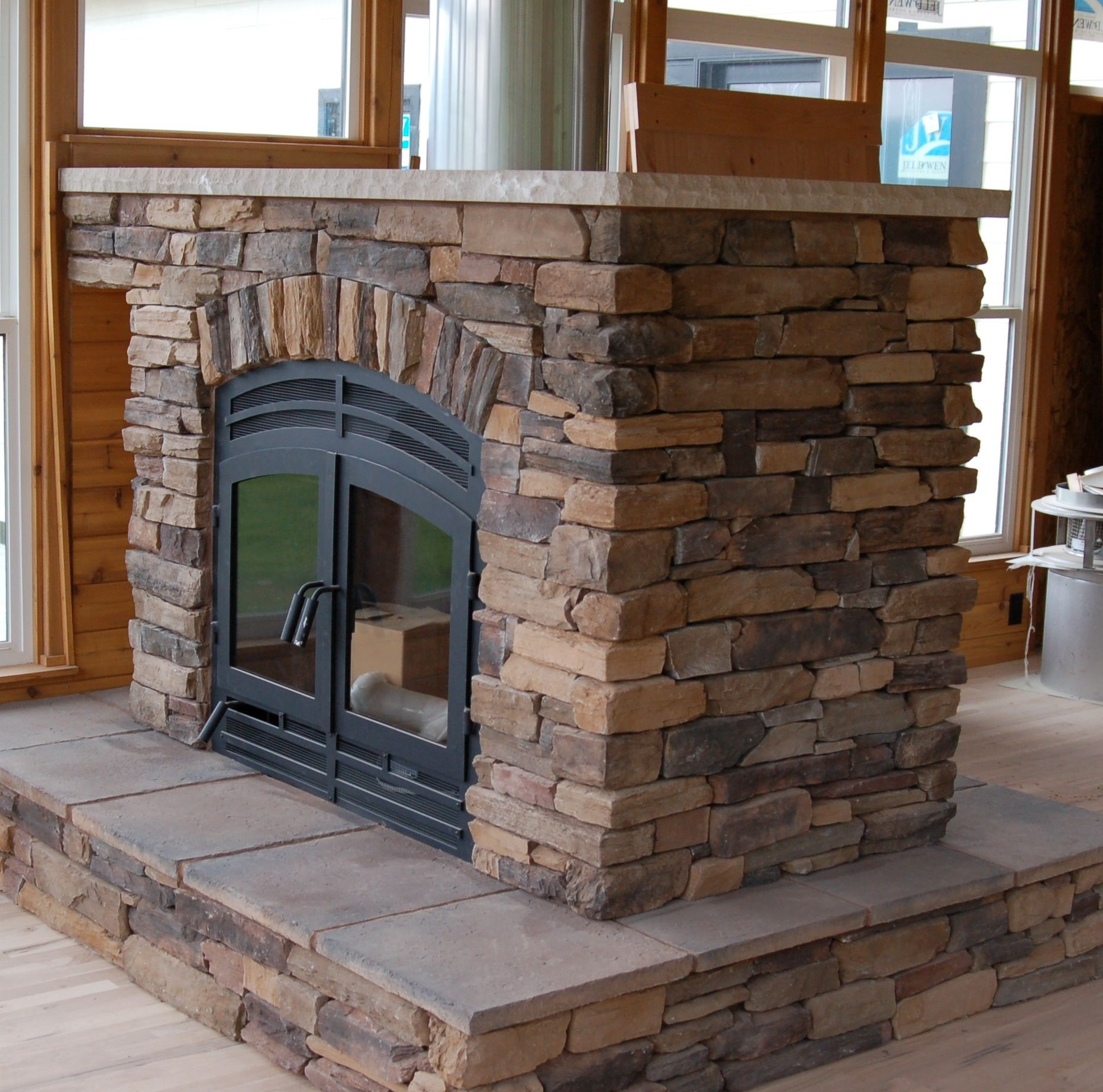 Traditional See Thru Wood Double Sided Fireplace With Brick Exposed Panels And Wooden Frames