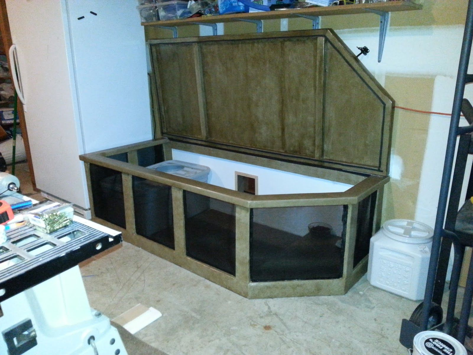 a cat door that leads into the garage into an enclosure where the cat box is kept diy one. Black Bedroom Furniture Sets. Home Design Ideas