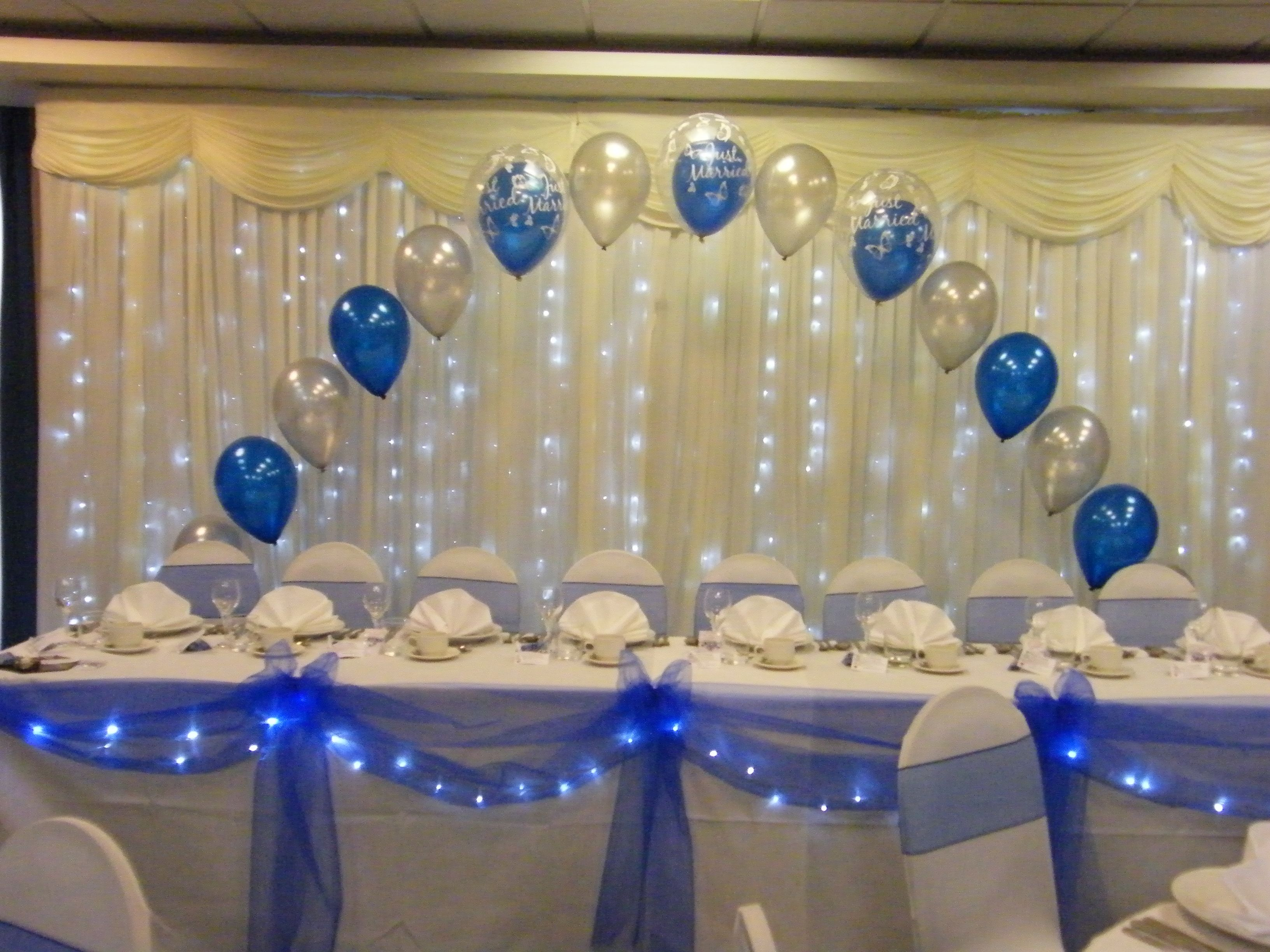 Wedding Top Table Arch Swags And Bows With Lights And Chair