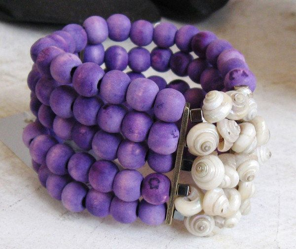 DB5 wood purple 5 elasticised strands hand dyed wooden beads with shell and hematite central motif ZAR 230