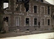 "This ruined building in Bucy reads ""Gott strafe England! 1914/15."" ""God punish England"" was a common German war cry, implying England needed to be punished for the harsh blockade they inflicted on Germany."