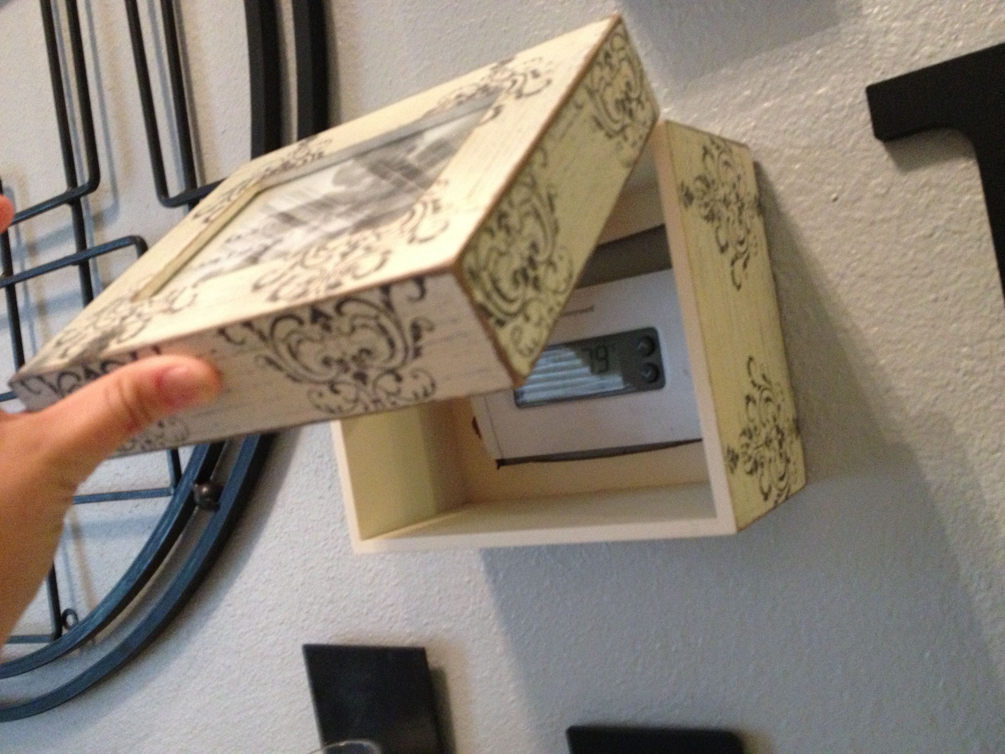 Use a decorative jewelry box to cover up your thermostat!