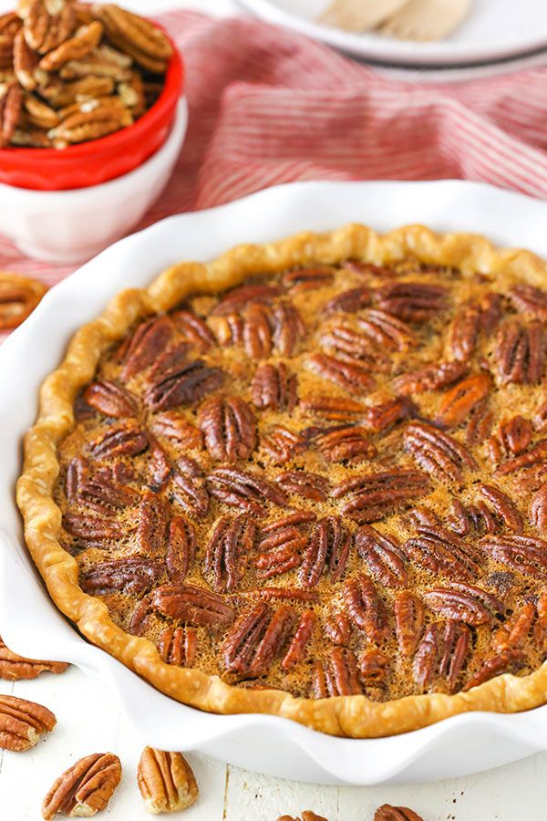 This Pecan Pie recipe is a classic! With a delicious pie crust, plenty of brown sugar & lots of pecans, you'll come back to this recipe time and time again. #pecanpie #thanksgivingdessert #christmastreats