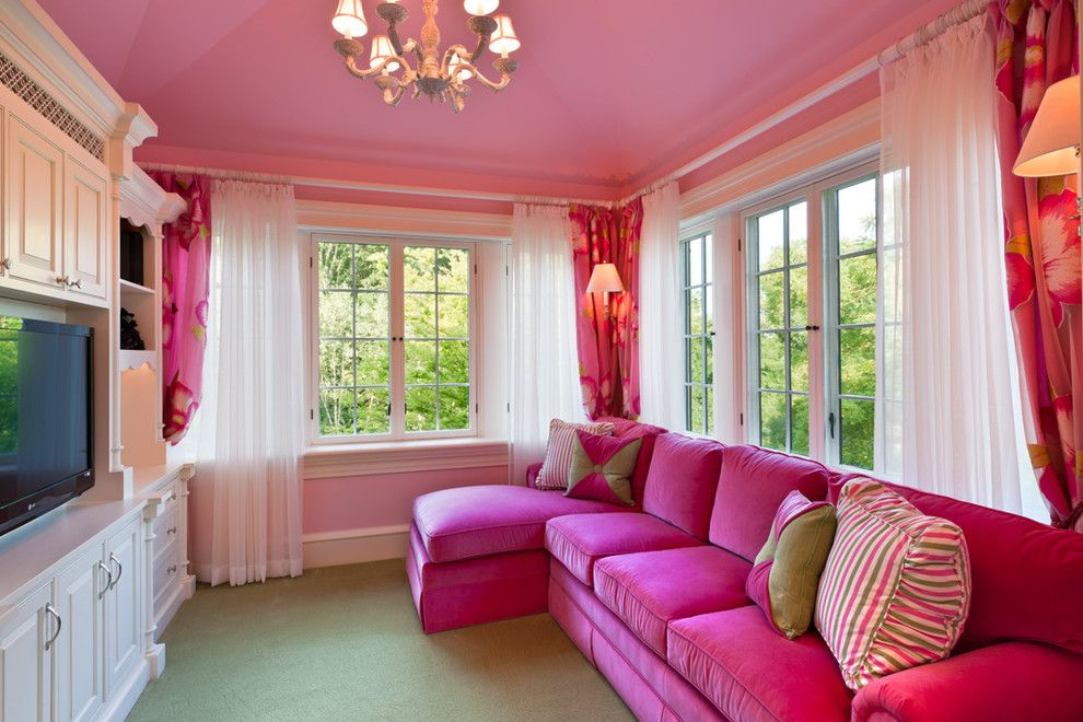 Modern transitional pink living room with pink sofa and brown carpet ...