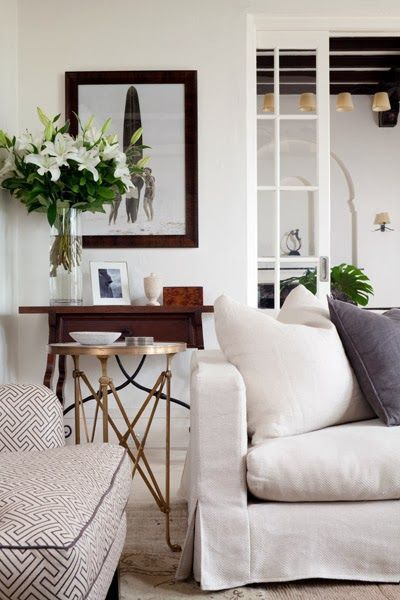 white light layers and dark wood accents elegant living room Get