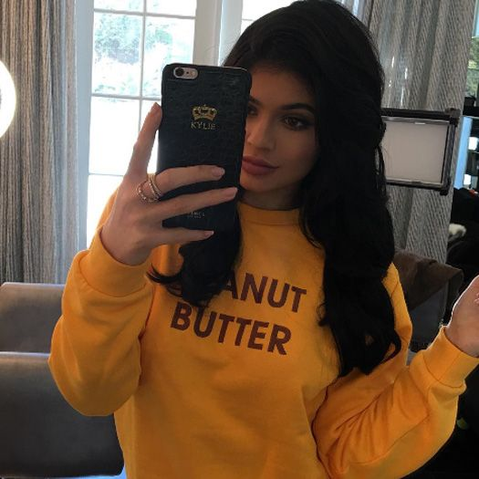 Kylie Jenner wears yellow Peanut Butter sweater from Rad ...