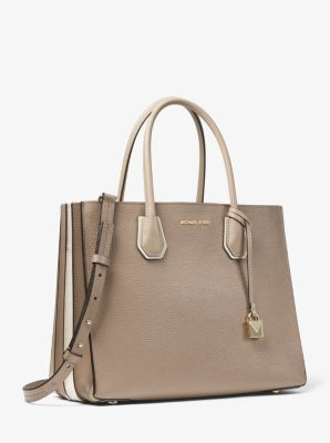 f3882bdc2381 Crafted from pebbled leather, our Mercer tote is updated with accordion  side gussets in a color-blocked finish. Tuck important items—such as your  keys, ...