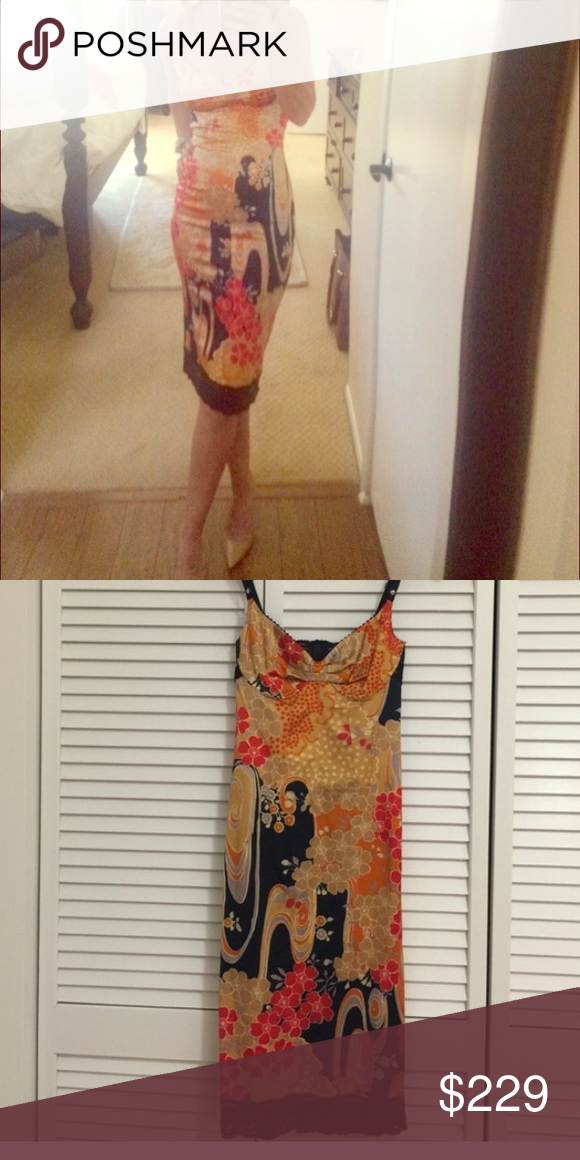 Dolce gabbana Asian print dress 0 xs I love this dress! Dolce gabbana slip dress. It does have some stretch to it. I'm a size 0-2 and recommend it for that. Dolce & Gabbana Dresses