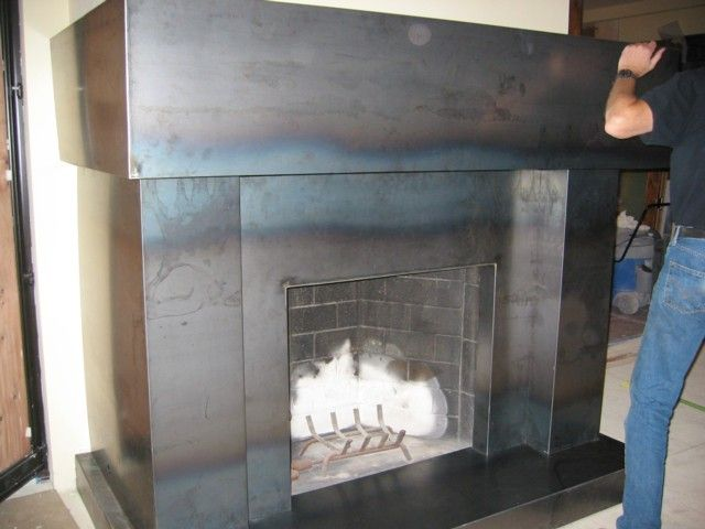 Here is a candid shot of a hot roll/natural steel fireplace and ...