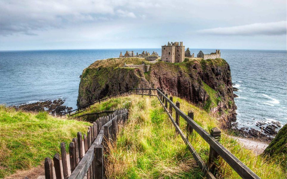 Dunnottar Castle, Scotland The clifftop fortress known as Dunnottar Castle is believed to have been first built in Scotland in the Early Middle Ages. Steeped in history, the castle's remains still include its 14th-century tower house as well as its 16th-century palace and was once home to the Earls Marischal, one of the most powerful families in Scottish history. The castle offers daily tours, though it does operate on a seasonal schedule and closes for inclement weather.