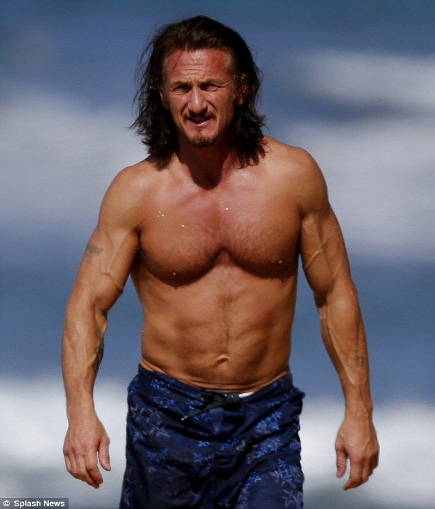 448e8a77 Still fit at 52! Sean Penn flexes his bulging biceps and six-pack on Maui  beach | Real cool | Sean penn, Bob weir, Men beach
