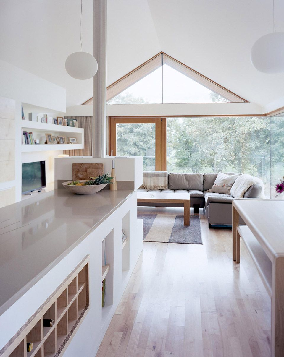 Inside of small house built around existing stone barn structure in ...
