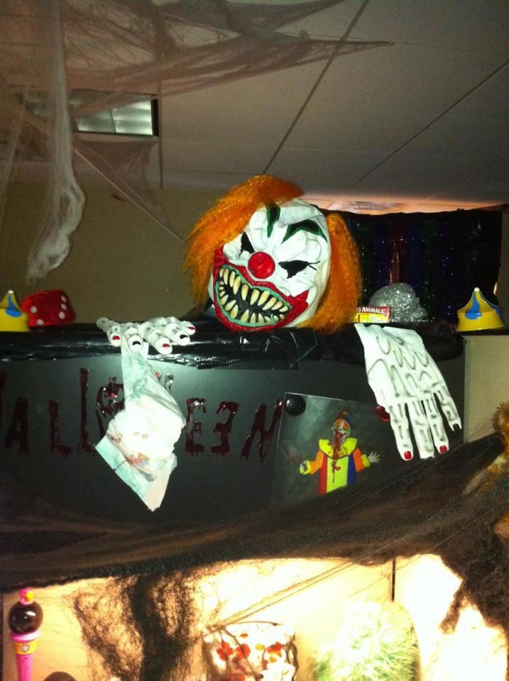 each of the client services cubicles were decorated as a scary halloween carnival act this one. Black Bedroom Furniture Sets. Home Design Ideas