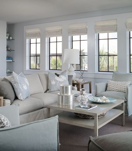 I like the breezy, cool look in this living room Especially like