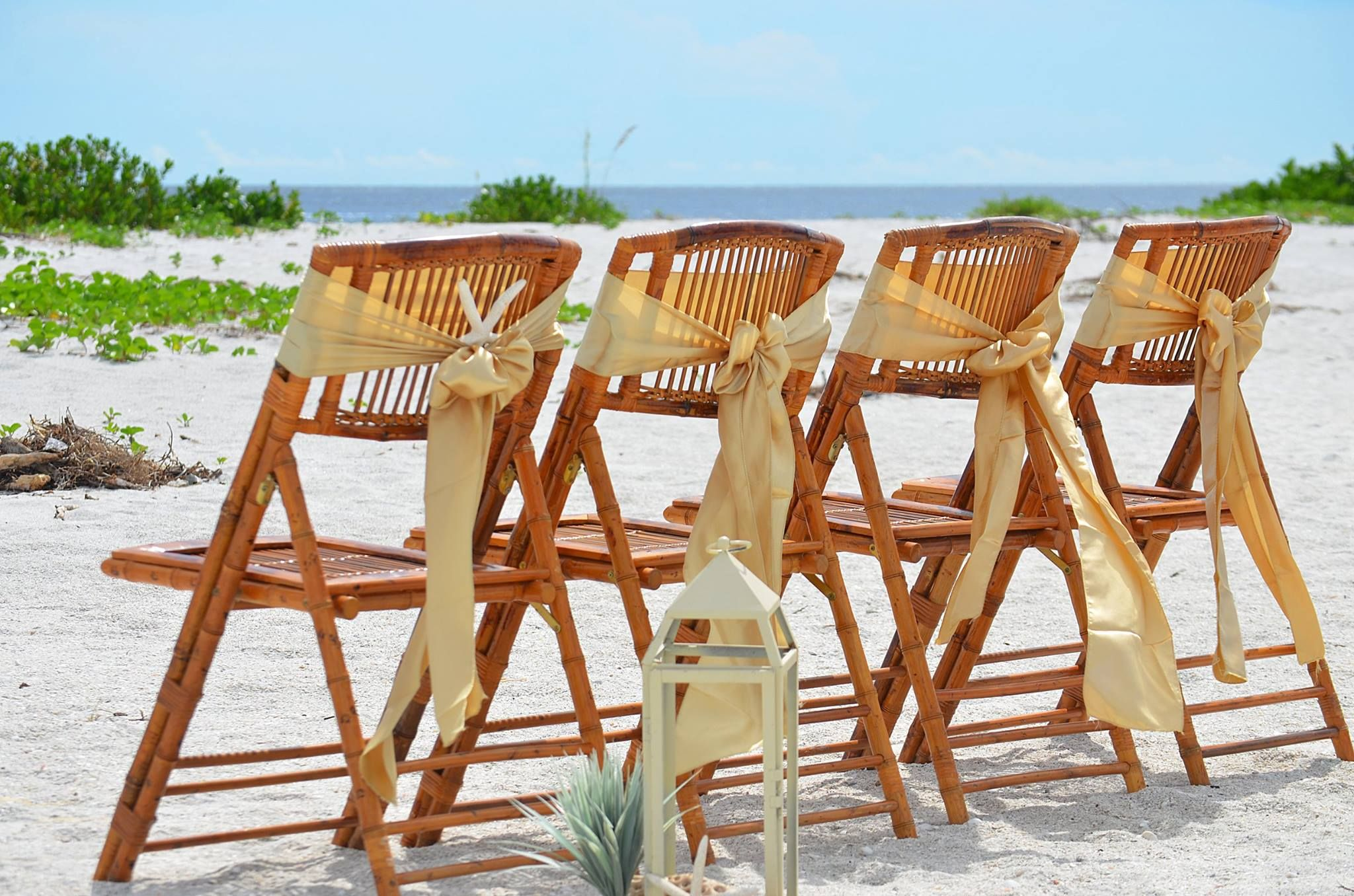 Bamboo wedding chairs starfish accents gold chair sashes glass