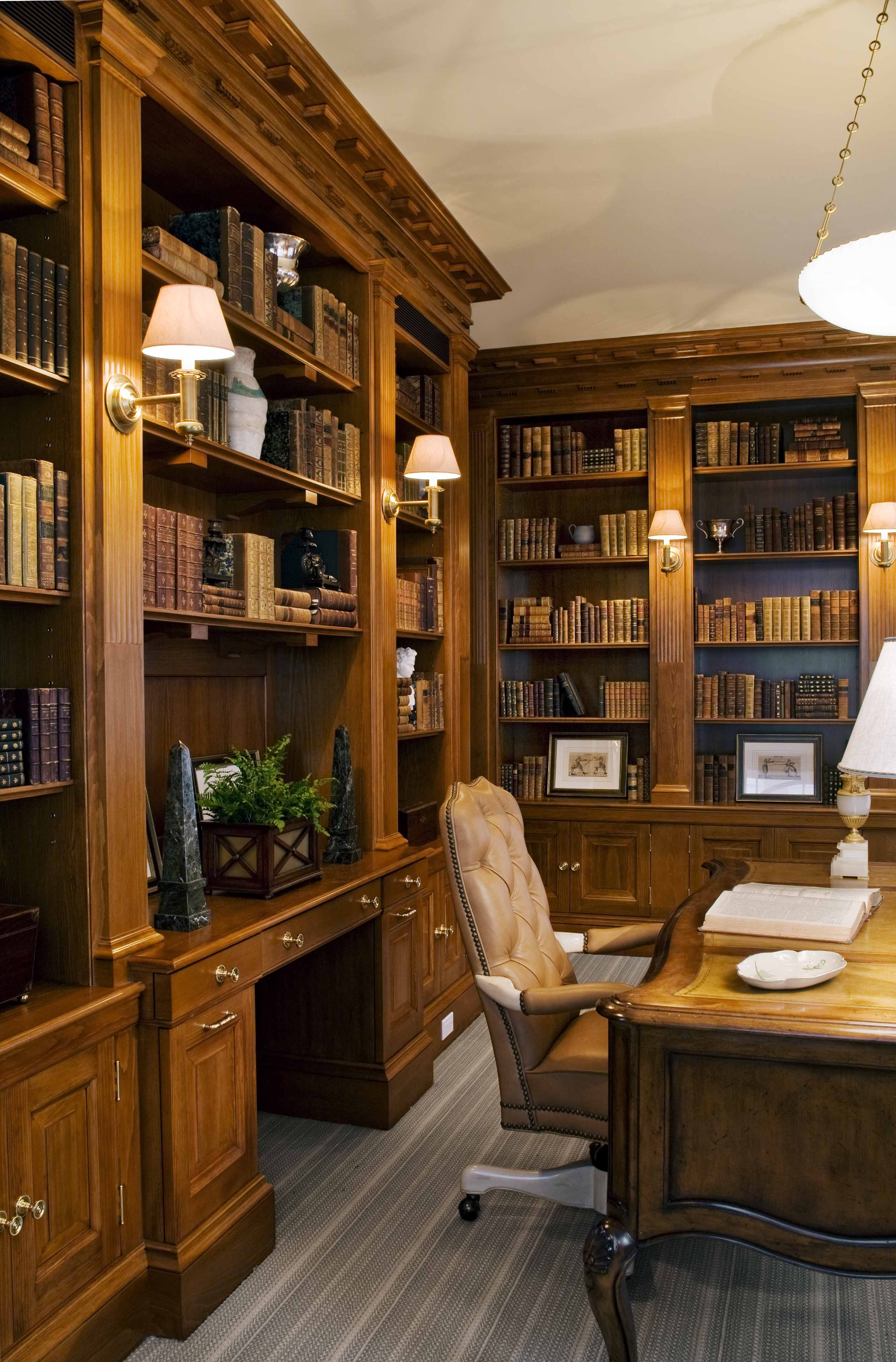 Home office with custom cabinetry shelving and dentil moulding