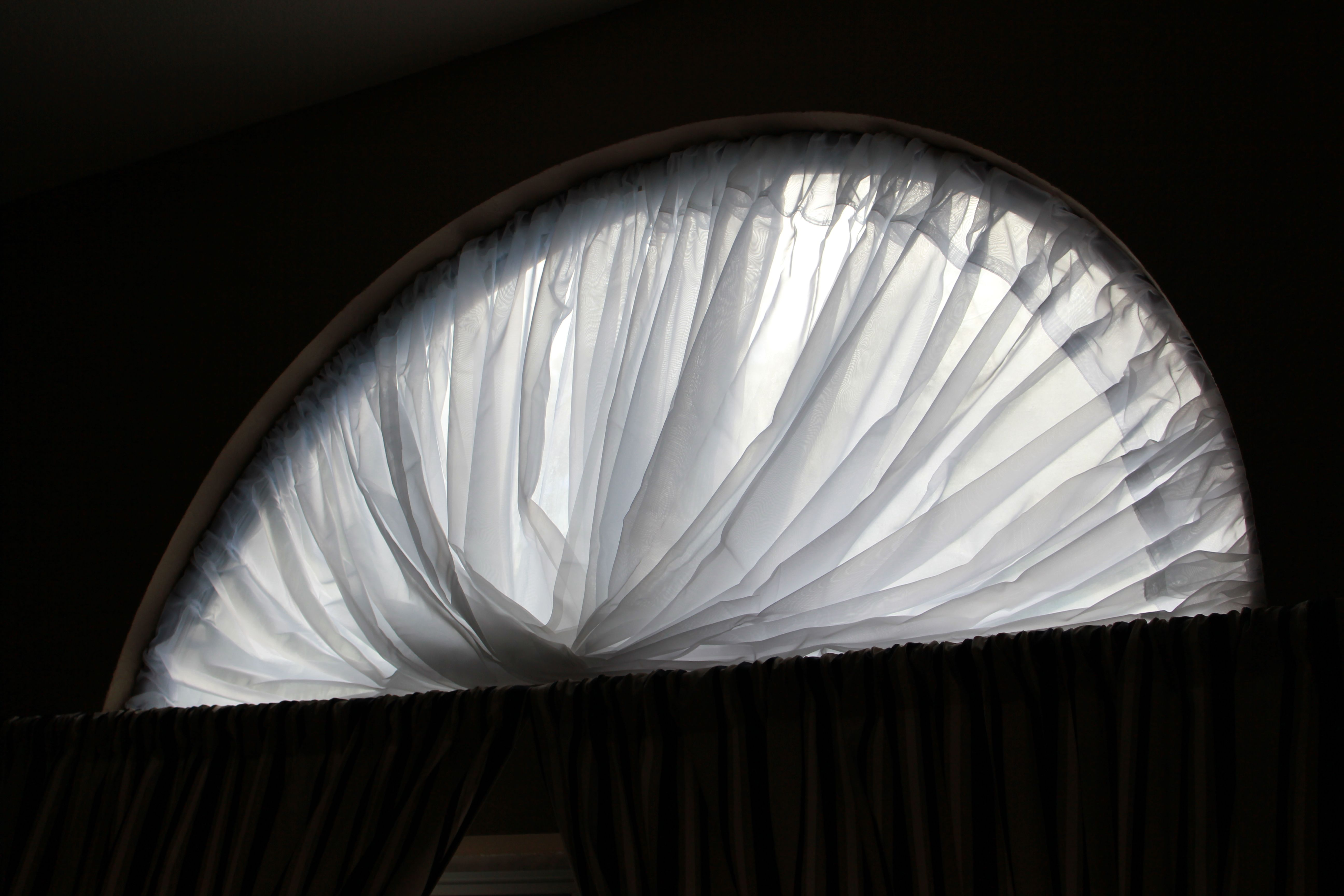 Beautiful Covering For A Half Moon Window Using Only A Hoola Hoop