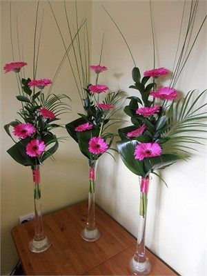 Lily Vase Arrangements For The Wedding Cards And Presents Table X