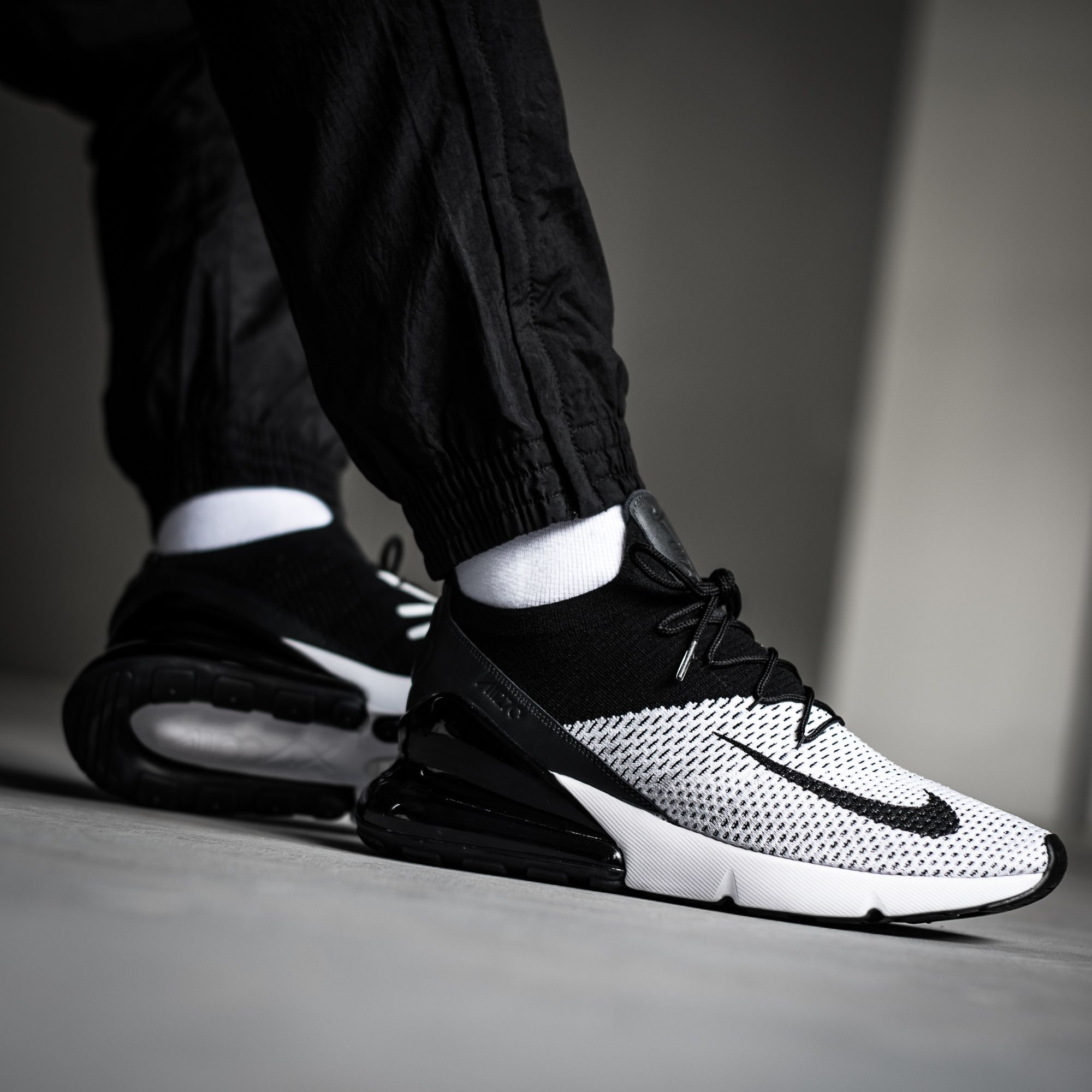 buy popular ff419 2c345 The brand-new NIKE AIR MAX 270 FLYKNIT in a white black-anthracite  colorway! Get yours on kickz.com!