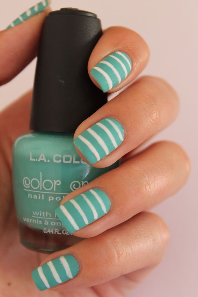 White stripes on a turquoise base, posted on Instagram @nails_bypau