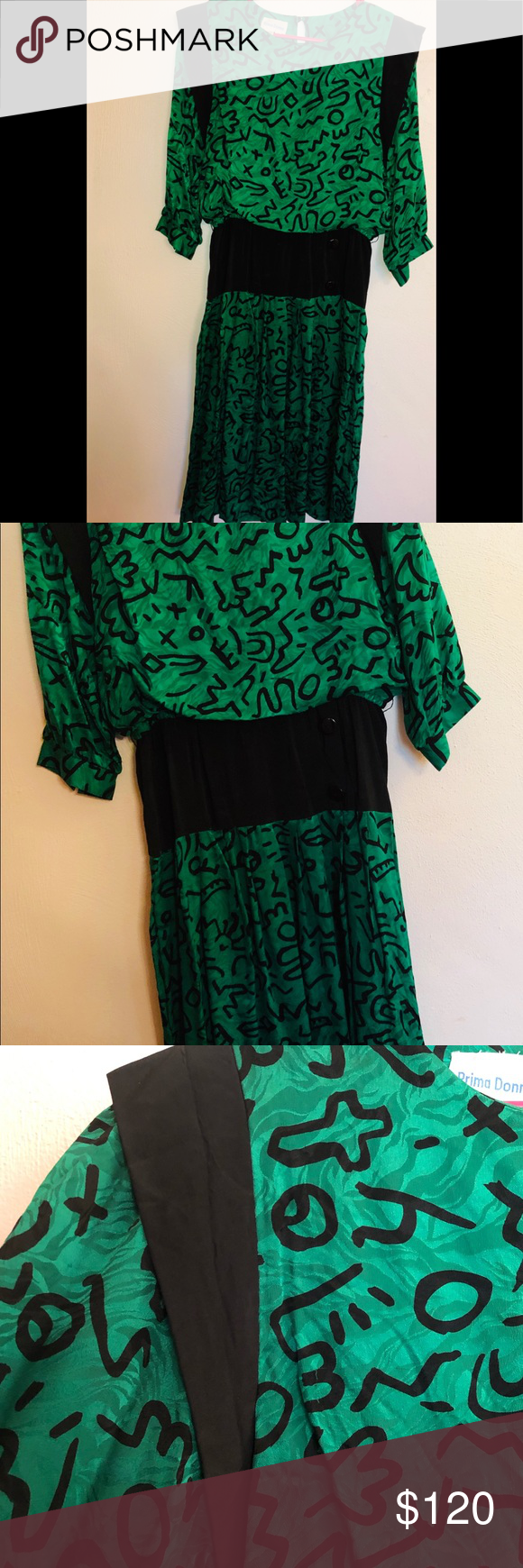 Silk 1980's New Wave EMO Dress Geometric Vintage Green and Black Geometric Pattern. Midi Dress with 1980's Triangle or Wing Pieces on the Shoulder. Waist is a band of material with buttons giving it that true Retro design.