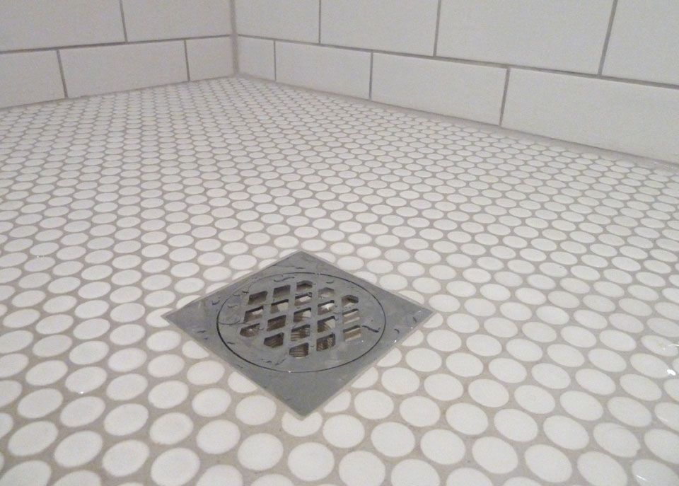 white penny rounds shower pan with white subway tiles - Tile ...