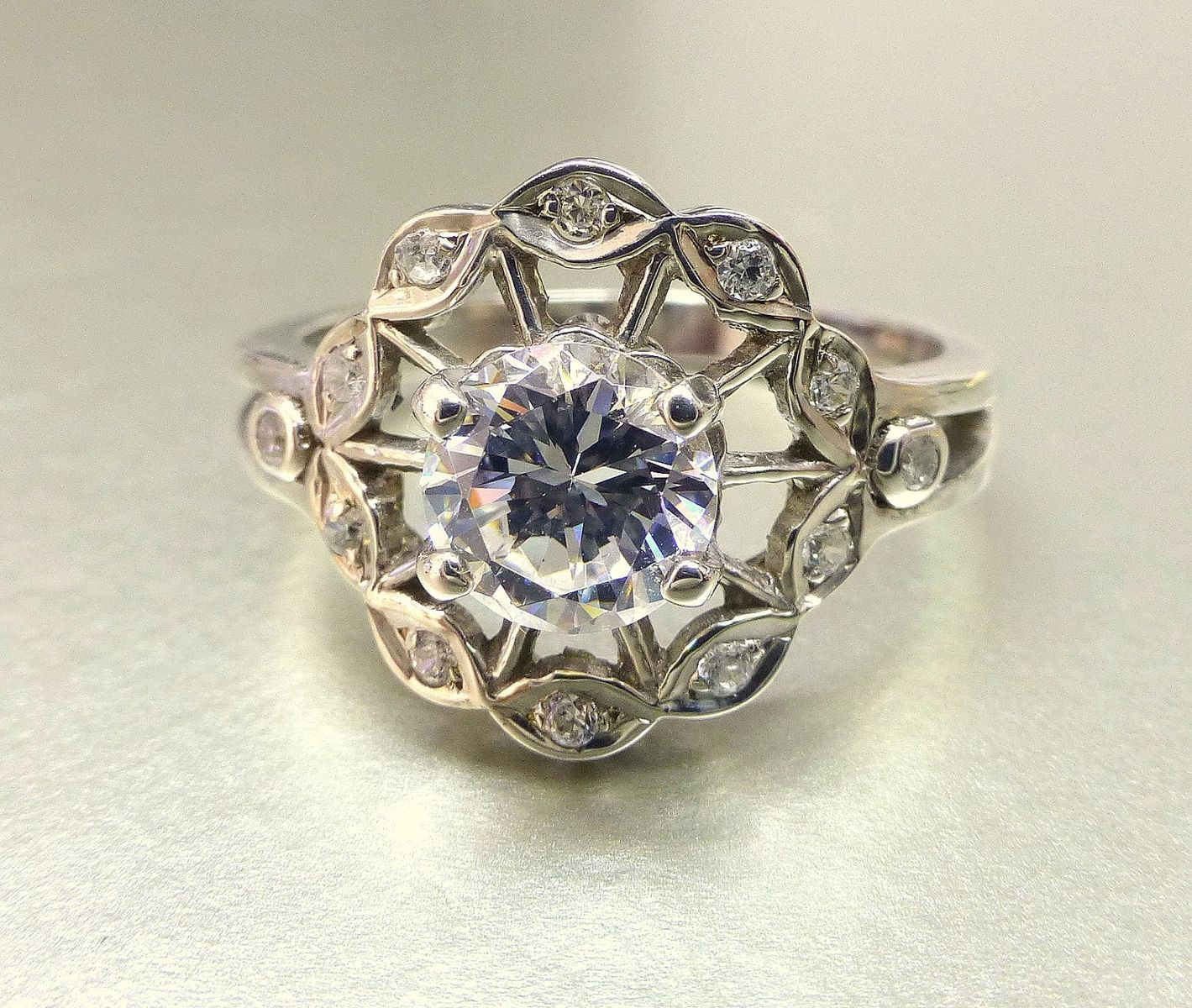 Custom made flower engagement ring with white sapphire all that