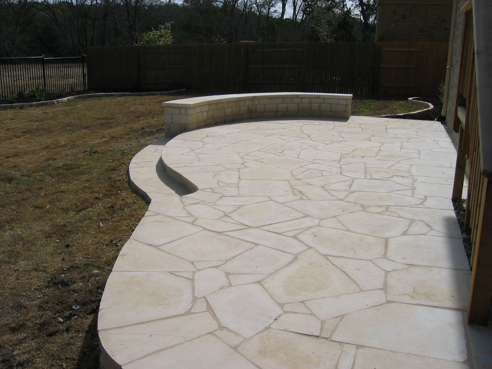 White flagstone patio constructed by ol 39 yeller for Landscaping rocks austin