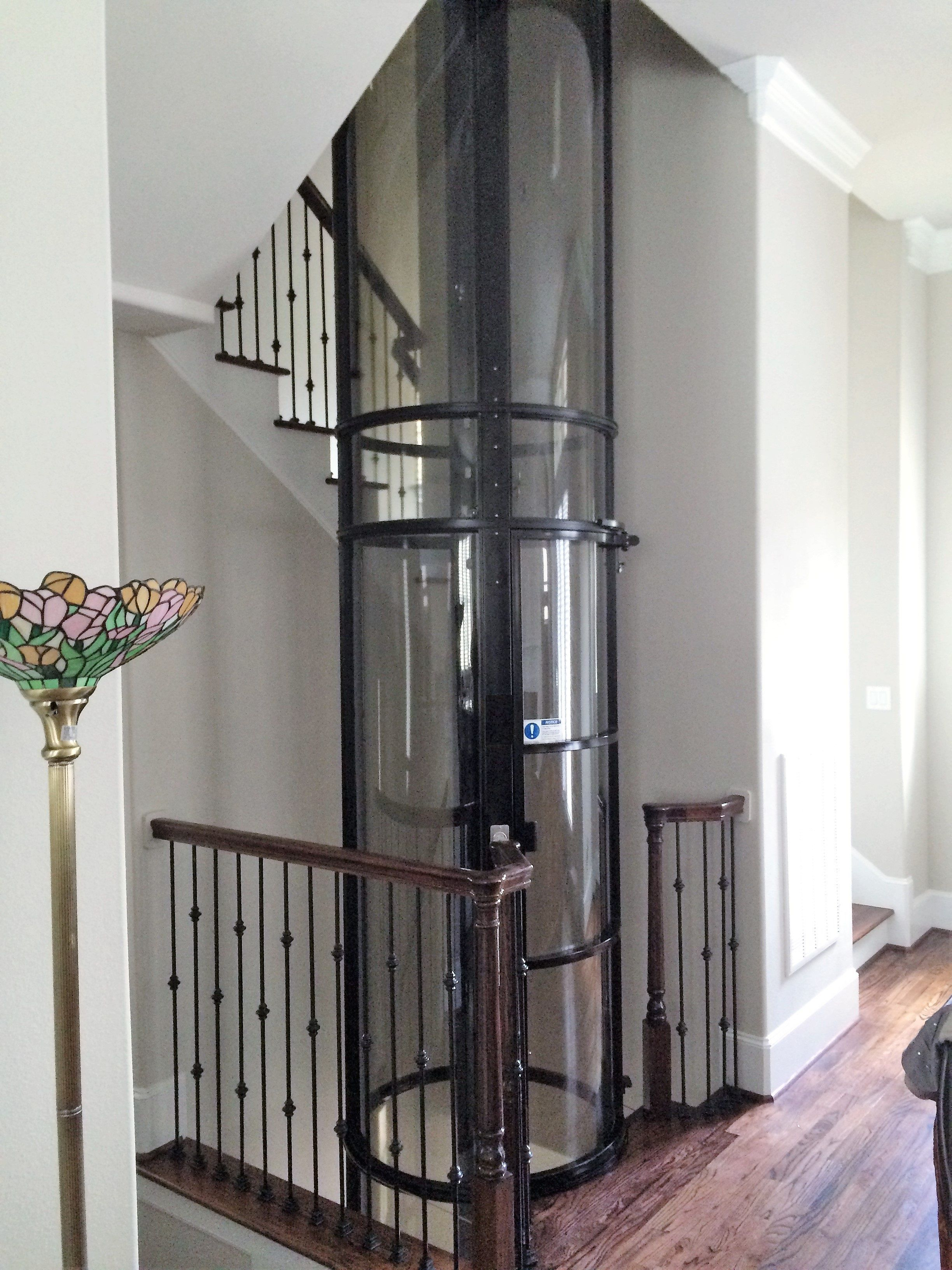Glass Home And Tube Elevator Cost Houston Texas Home Elevator Of Houston Tiny House Stairs House Elevation Elevation