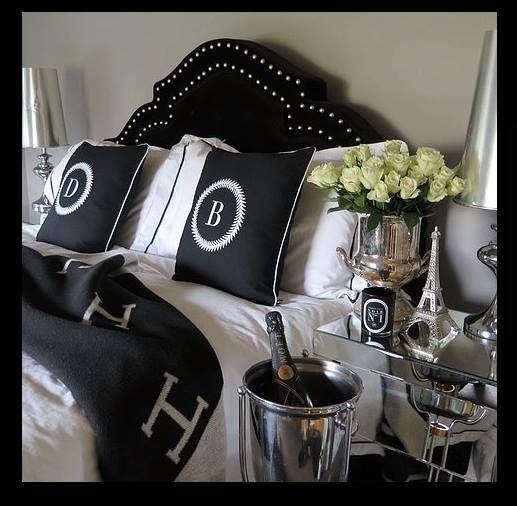 Hermes Avalon blanket | black and white | champagne | luxury | studded headboard | white roses | bombardier pillows | European