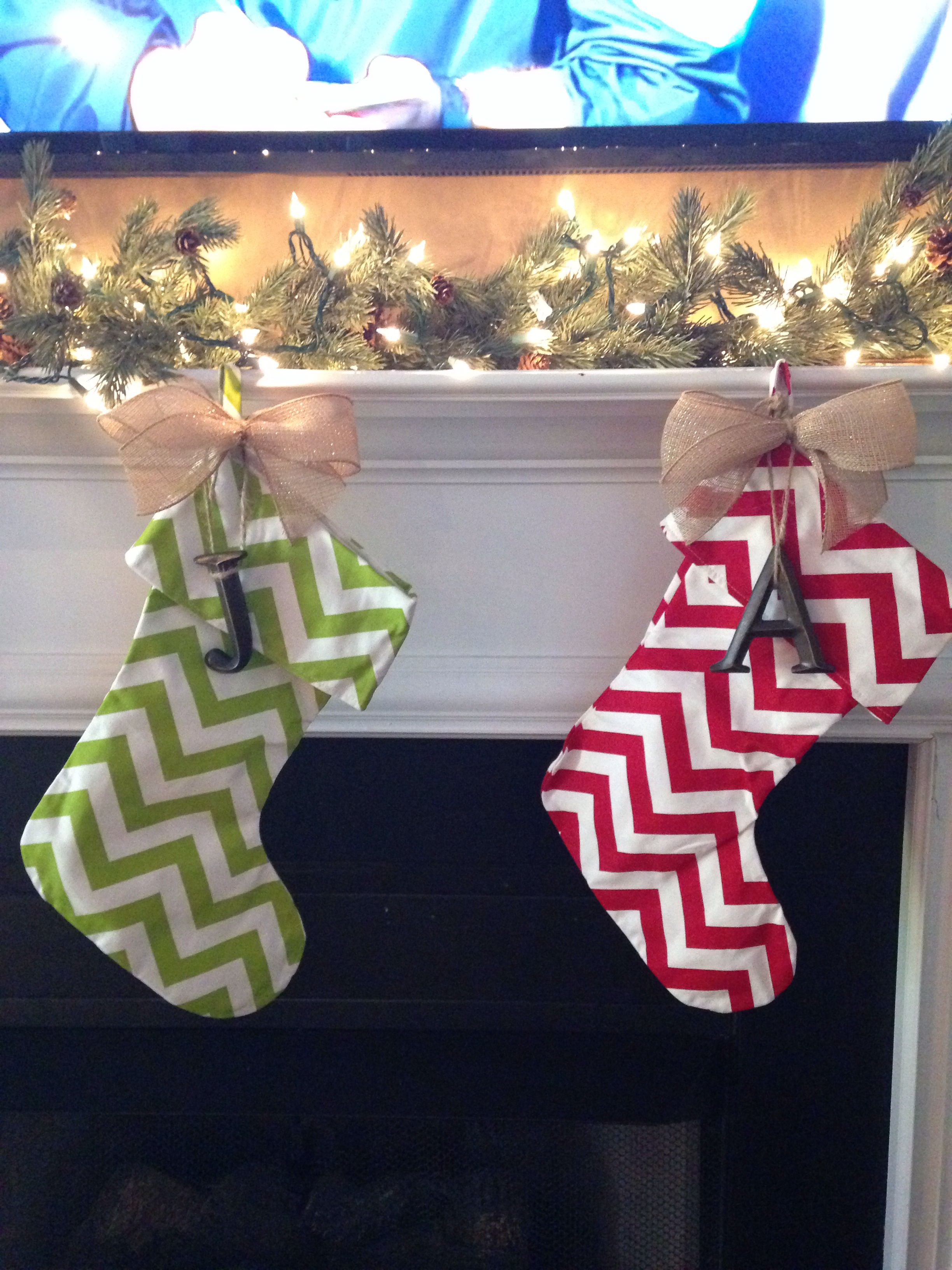 Christmas stockings! Chevron with burlap bow and initial. You can find twine, letters and bow at hobby lobby.