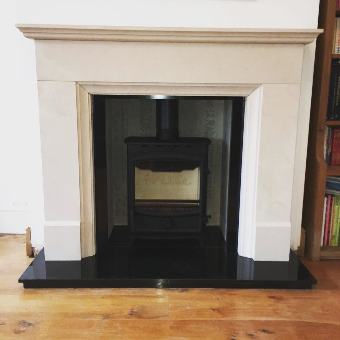 lovely new install of a bespoke limestone fireplace and the