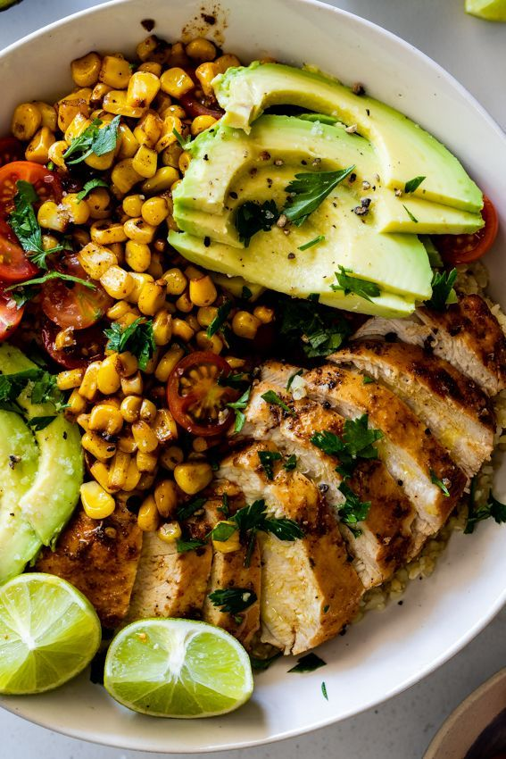 Mexican chicken lunch bowls. Juicy chicken breasts on top of fluffy quinoa and bulgur wheat with creamy avo and charred sweet corn is the perfect healthy make-ahead lunch.