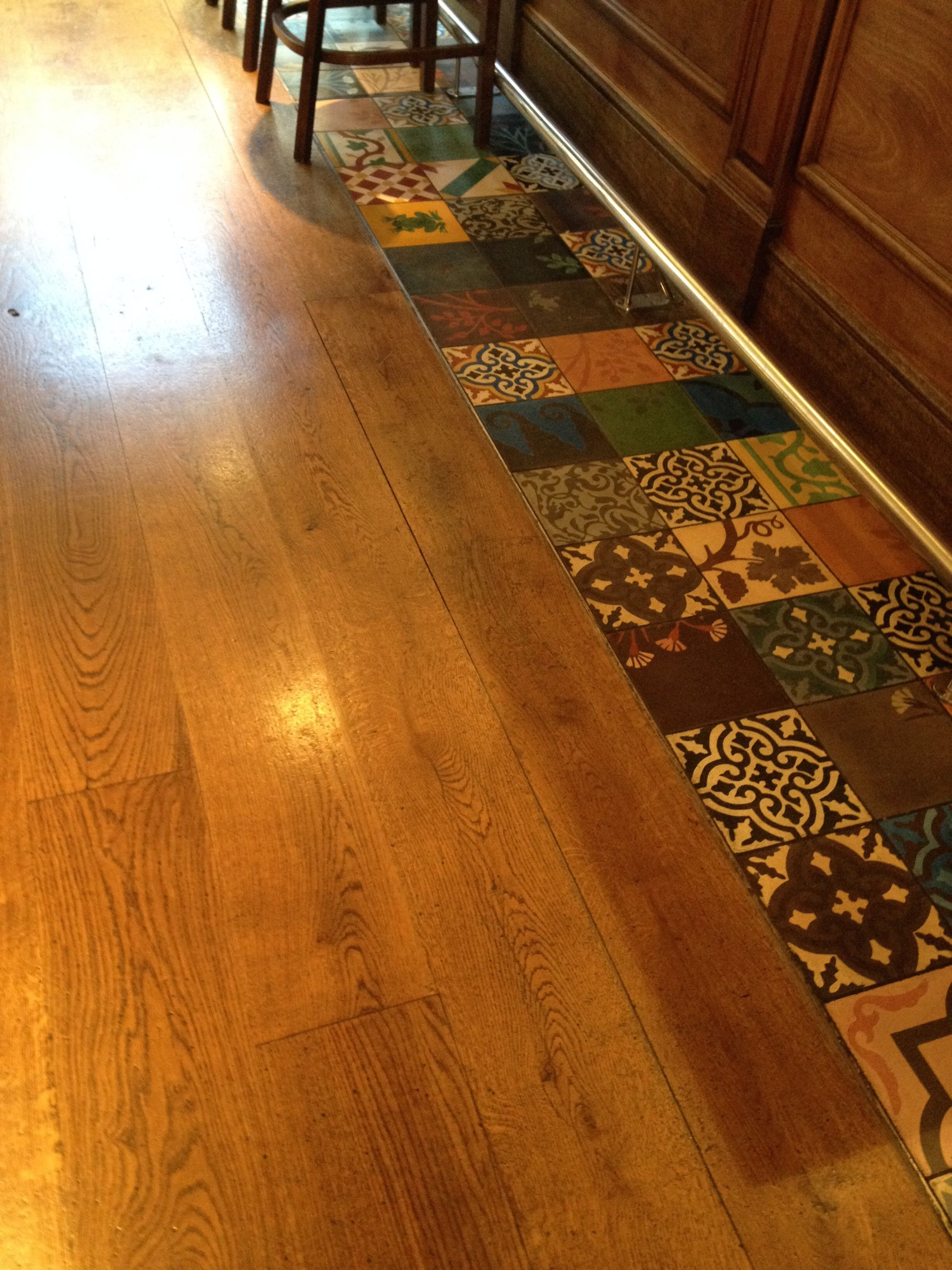 Wood And Eclectic Tile Flooring Combined Upstairs In Restaurant