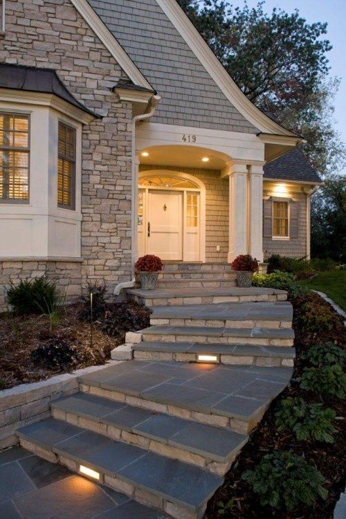 front entry steps and stone with painted cedar front of house ...