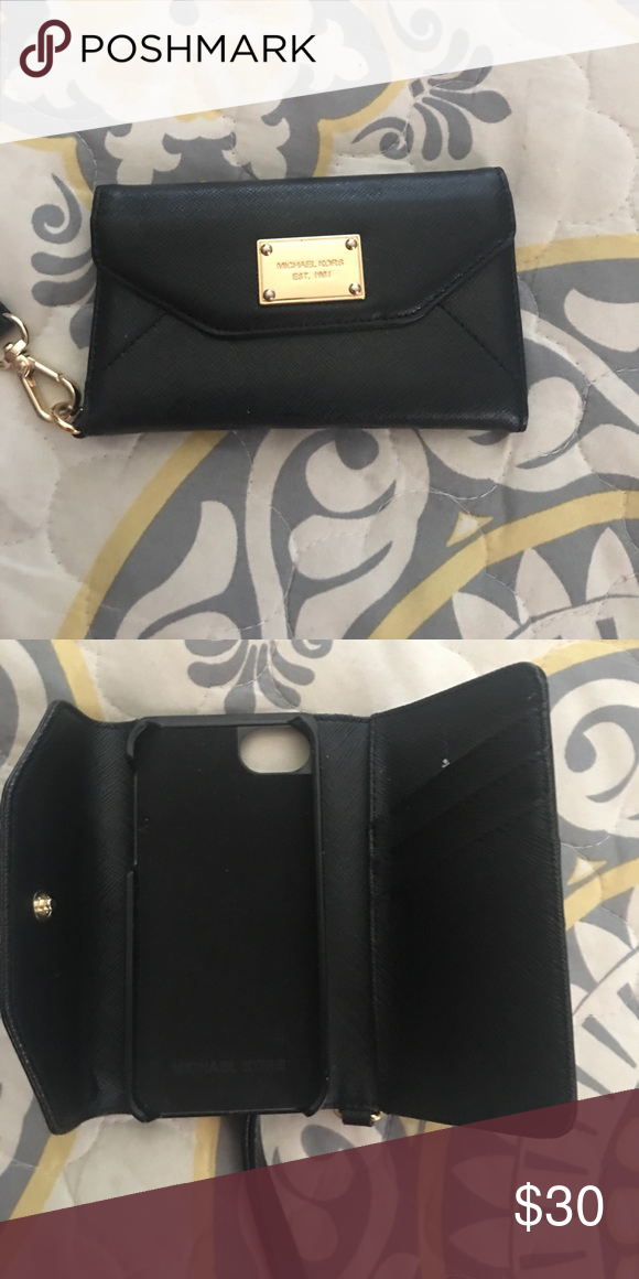Michael kors phone case wallet For a iPhone 5. Excellent condition used once Michael Kors Accessories Phone Cases
