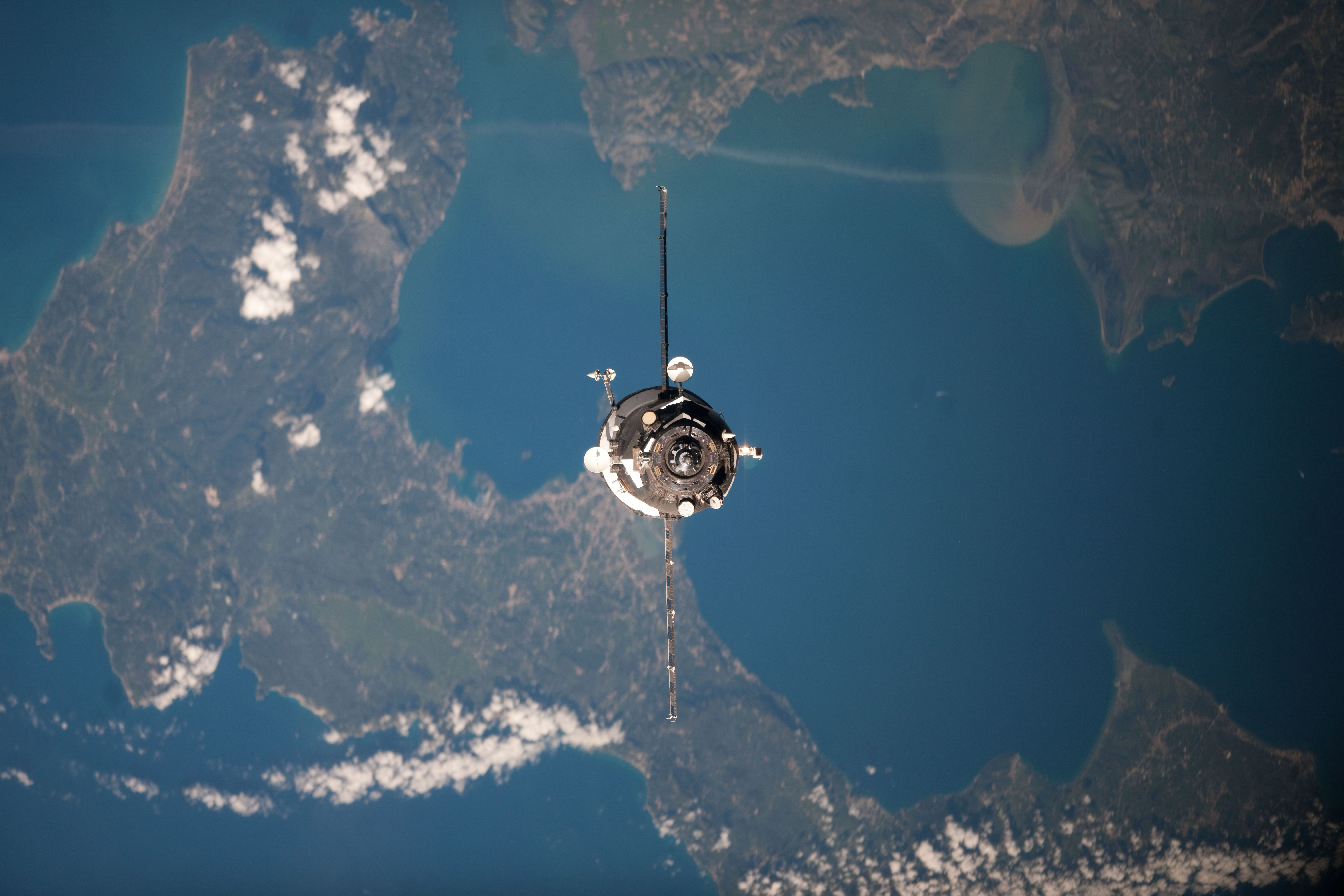 Far above Greece and Albania, an unpiloted Progress resupply vehicle approaches the International Space Station, carrying 2.8 tons of food, fuel and supplies. 04/22/12