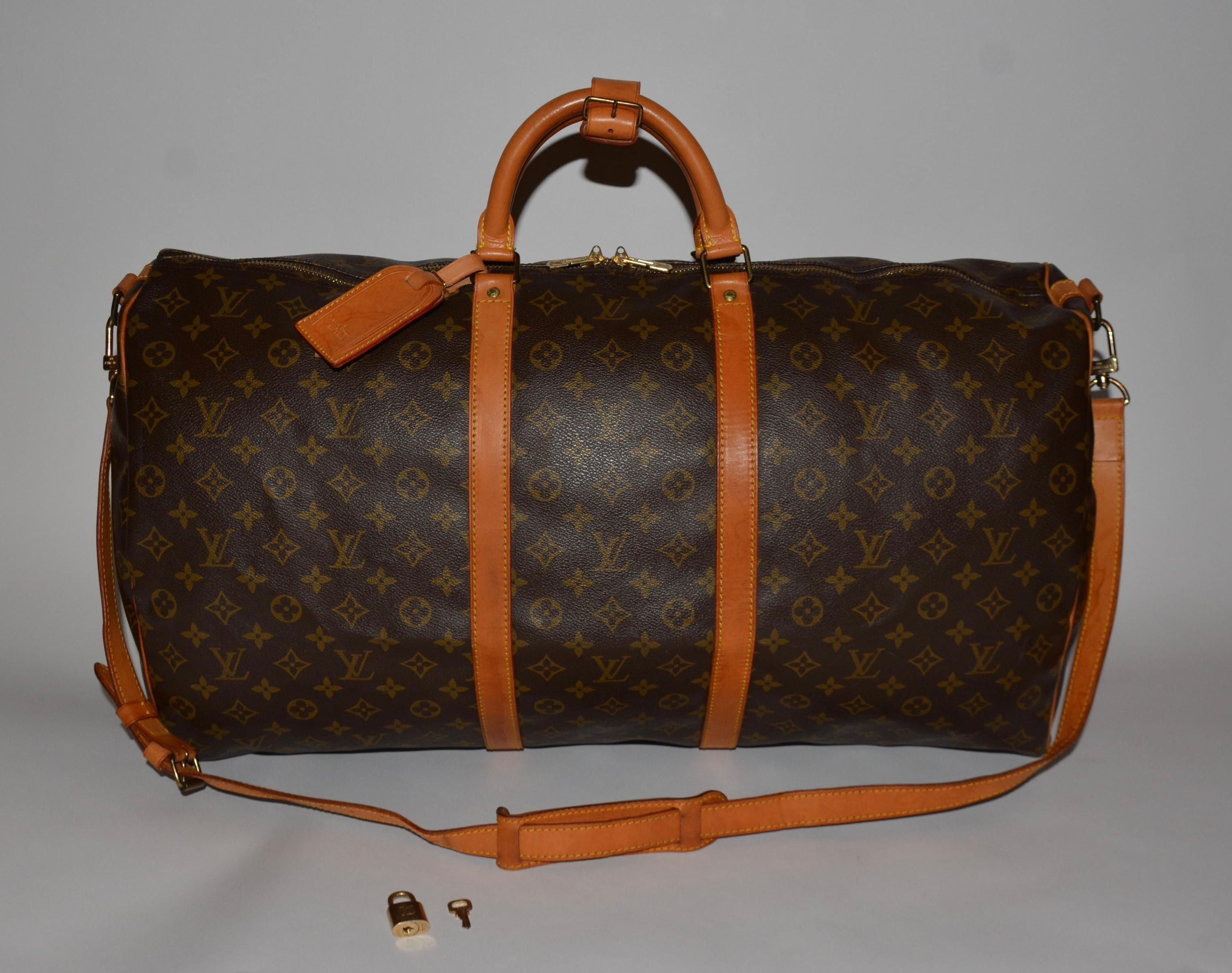 423794a7273d Save 73% on the Louis Vuitton Monogram Canvas Keepall Bandouliere 55 Brown  Travel Bag! This travel bag is a top 10 member favorite on Tradesy.