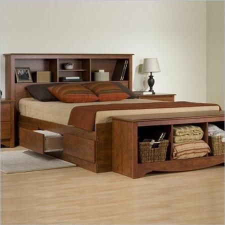 A bed like this would be great for a small space, to give the extra storage!  http://www.walmart.com/ip/Prepac-Monterey-Cherry-Queen-Bookcase-Platform-Storage-Bed/39134503