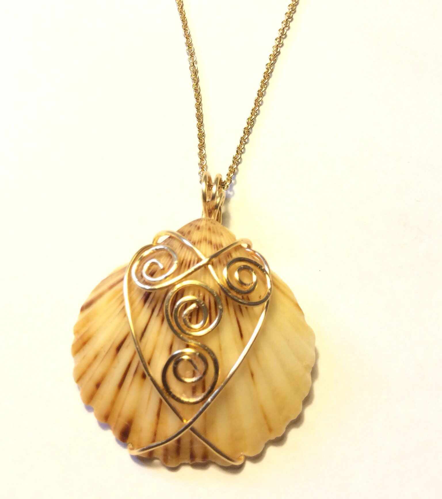 Photo of Gold Wire Wrapped Scallop SeaShell Pendant with White Swarovski Pearl and Aquamarine Bicone Bead