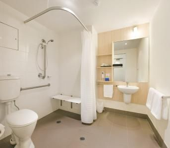 wheelchair accessible bathroom | open showers, bathroom layout and