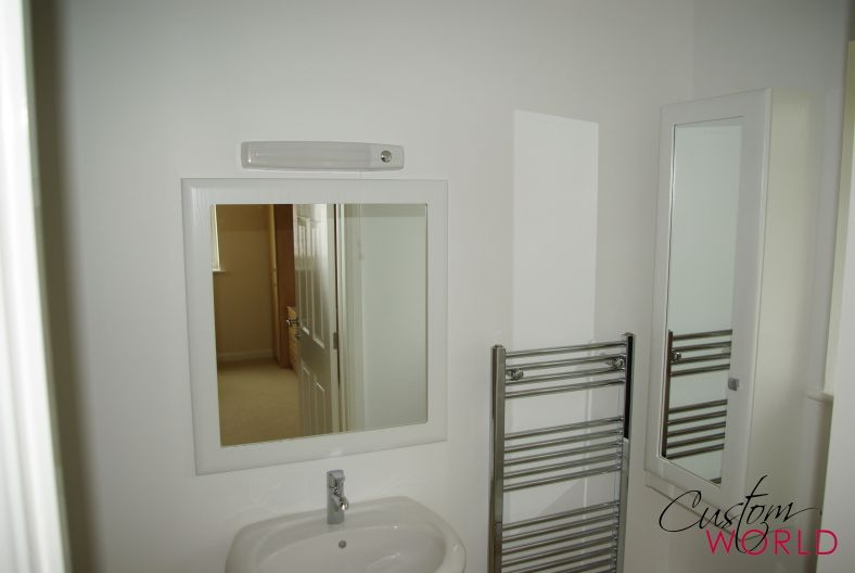 Matching Made To Measure Mirror For A Bathroom In White Fitted Bathroom Furniture Wall Cupboards Under Sink Storage