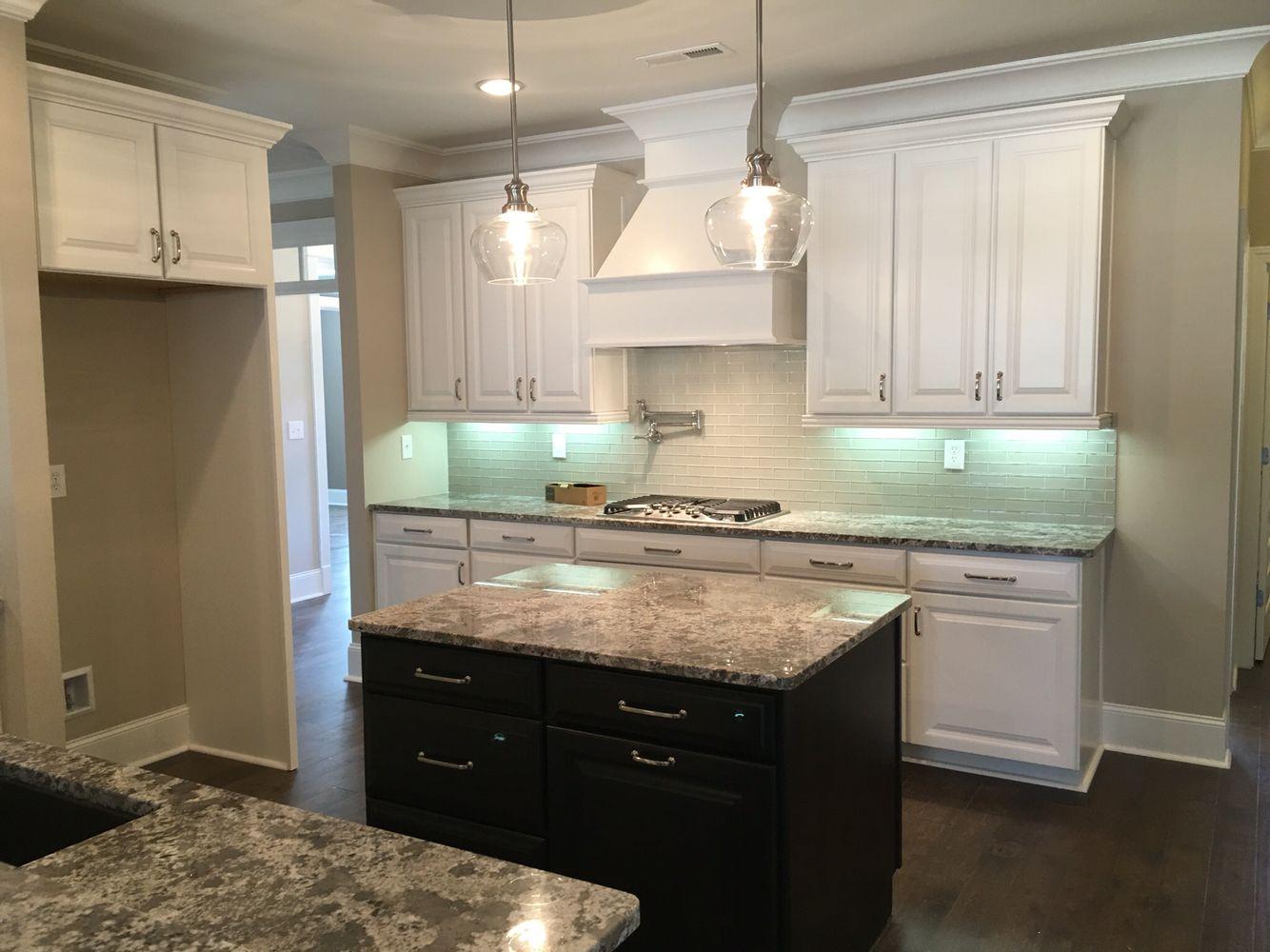 bianco antico granite, espresso island, white wall cabinets, mist
