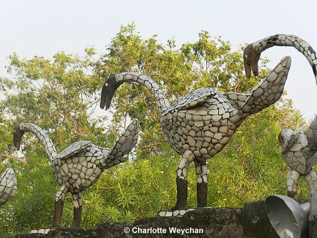 Rock Garden in Chandigarh,  the sculpted water birds adorning the entrance wall. the garden has become as popular with locals as tourists, . Nek Chand started creating this magical kingdom over 60 years ago, just as Chandigarh India was under construction. He has worked here ever since, and now aged 86, he continues to