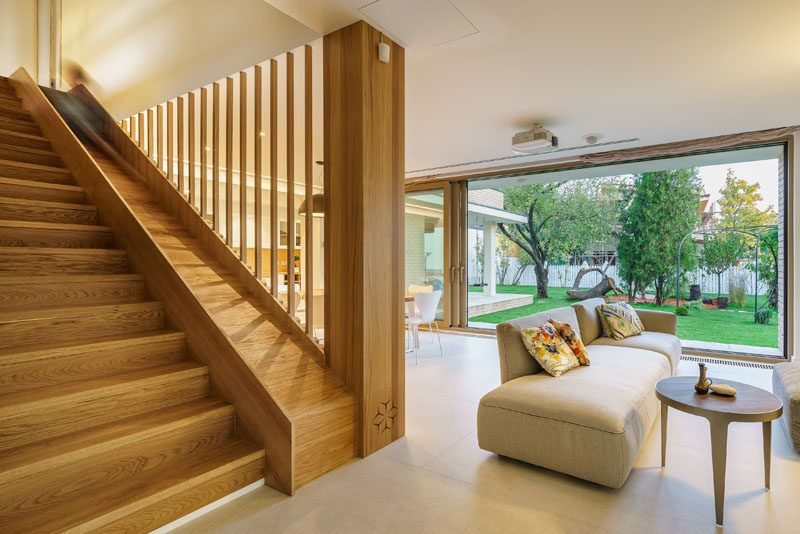 A Built In Slide Makes The Wood Stairs In This House Fun For Kids