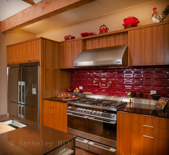 Cheryl's Kitchen featuring Custom built Berkeley Mills Cabinetry, built with FSC® certified Teak. And out fitted with Fisher Paykel Appliances Three Ovens, One Range, their new CookSurface Deep cooktop, and Refrigerator Microwave and Dish Washer all placed in an open and inviting space with views of the Napa country side for inspiration.