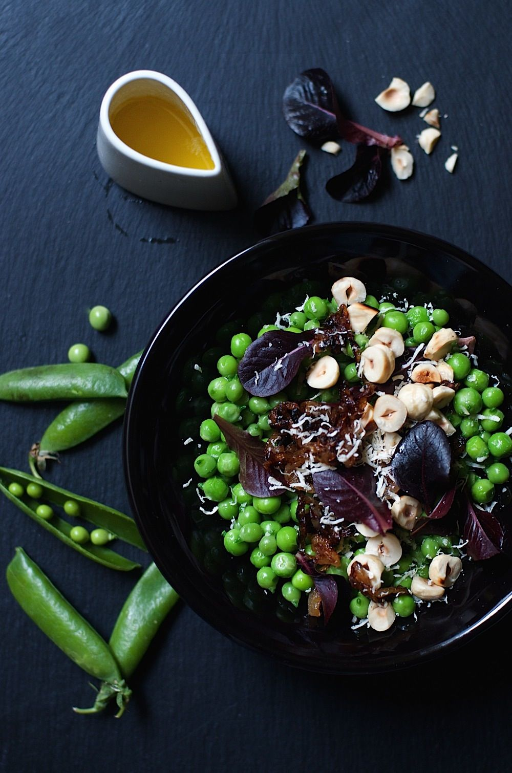 green peas with caramelized onion and hazelnuts.