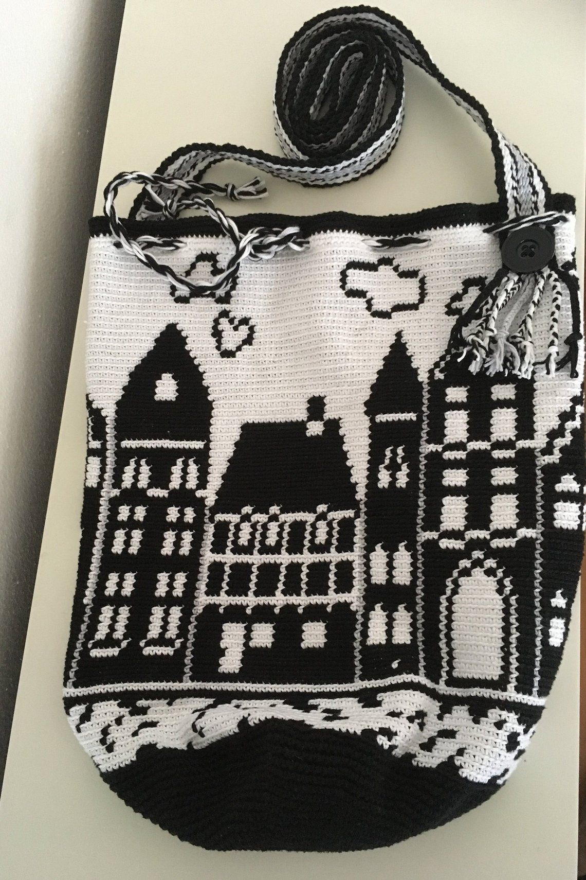 Photo of Wayuu mochila bag with tapestry technique, Amsterdam Canal Houses, Crochet pattern, black and white, PDF-file, DIY
